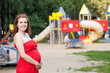 pregnancy woman against  playground