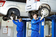 auto mechanic at car suspension repair work - 49195126