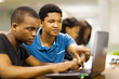 african college students using laptop together