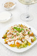 fruit salad with nuts, yogurt and mint, vertical