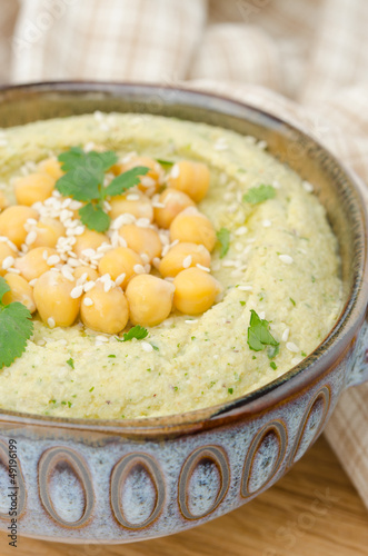 Hummus with cilantro, closeup, selective focus