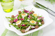 salad with quail eggs, feta and arugula