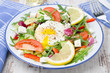 Vegetable salad with poached egg on a plate, horizontal