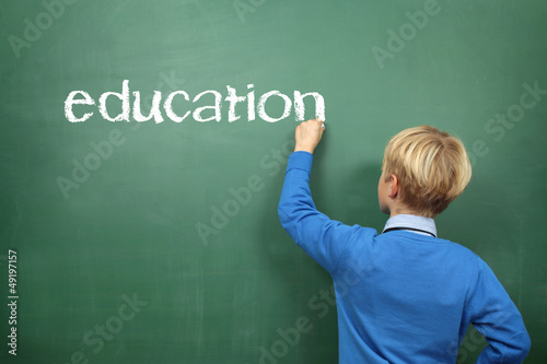 Education Schoolboy at the Blackboard