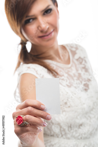 Beautiful woman presenting a business card