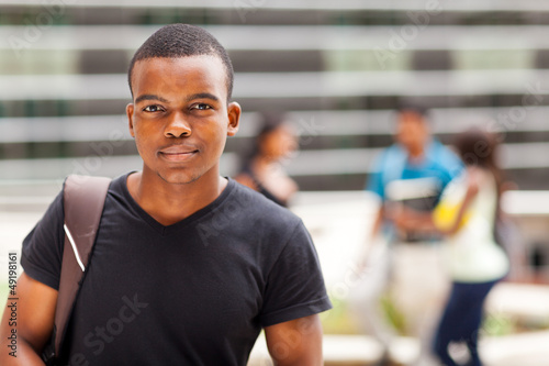 african college boy standing outdoors