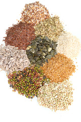 Mixed seeds arranged on a white background