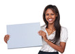 Studio shot of an attractive woman holding up a blank sign for c