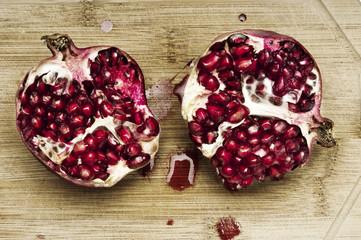 Cutting pomegranate closeup