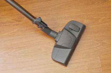 Vacuum cleaner cleans floor