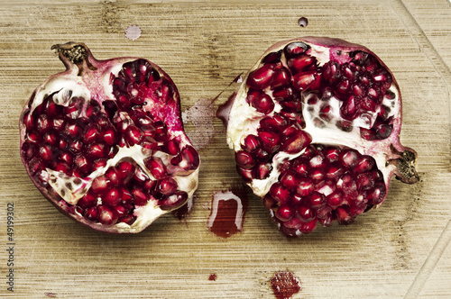 Cutting pomegranate closeup