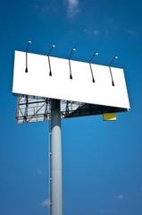 Empty advertising banner against blue sky