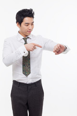 Young business man consulting his watch