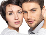 Closeup portrait of beautiful couple - isolated
