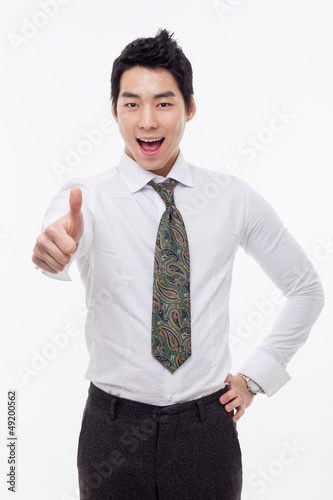 Showing thumb young Asian business man.