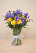 Vase of Yellow Roses and Purple Irises