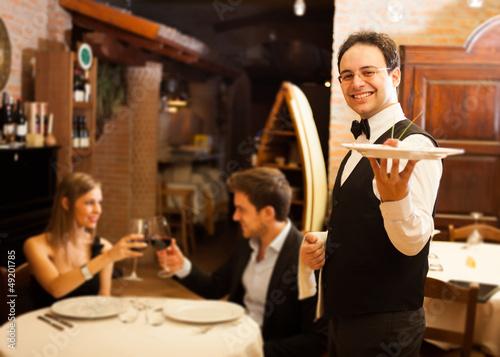 Waiter serving dinner