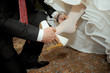 Putting on Wedding Shoe