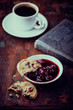 Still life with cranberry cookie, cherry marmalade and coffee