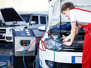 Car mechanic checking the air handling unit of a car