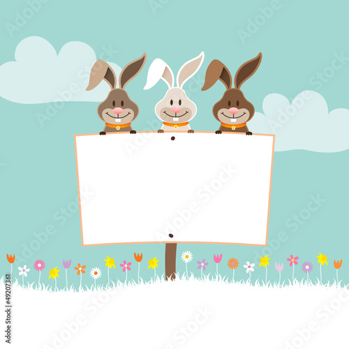 3 Bunnies Holding Easter Egg Label In Meadow Retro