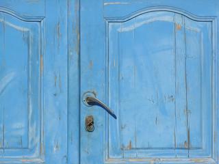 Old blue wooden door with handle
