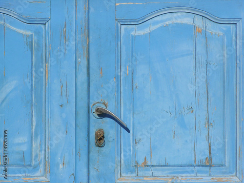 Old blue wooden door with handle