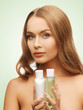 woman with cosmetic bottles