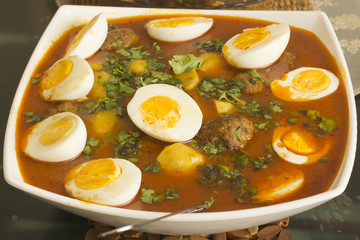 Chicken Koftay served with boiled eggs and parsley