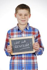 child holding slate