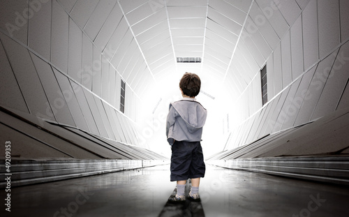 Child walking towards the tunnel