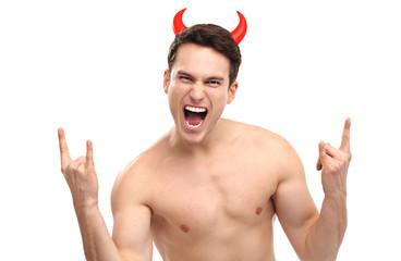 Man wearing devil horns