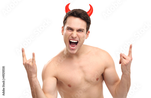 Man wearing devil horns