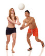 Young Couple Playing Volleyball