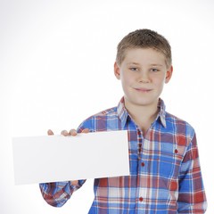 boy standing with empty horizontal blank in hand