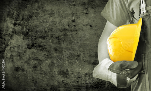 Worker and grunge texture in background