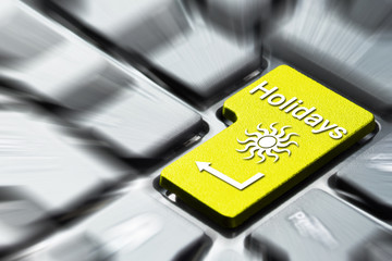 Book holidays button on the computer keyboard