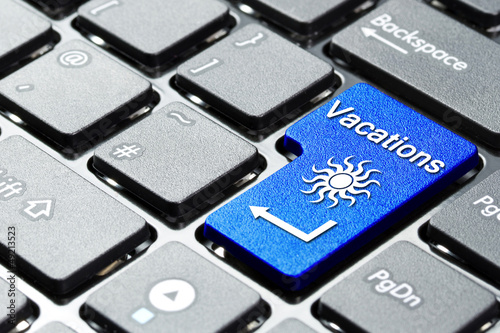 Book vacation button on the computer keyboard
