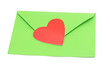 close-up of green paper envelope with red heart