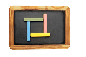 Set of colorful chalk on blackboard