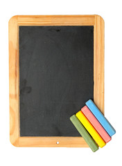 colorful chalks on blank blackboard