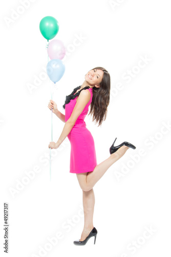 Young happy girl with colorfull balloons