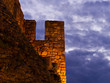 Fortress walls and heavy clouds