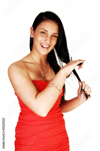 Girl cutting her hair.