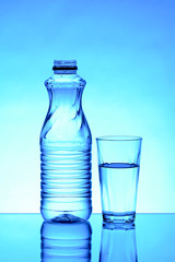 Water bottle with glass isolated blue backgorund