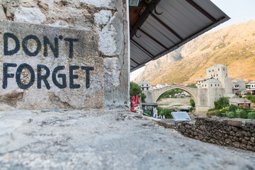 Mostar bridge and Don't Forget sign