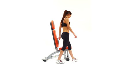 Slim brunette woman on hydraulic exerciser