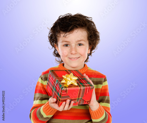 Beautiful child giving a present