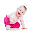 Funny baby sitting on the floor, isolated over white