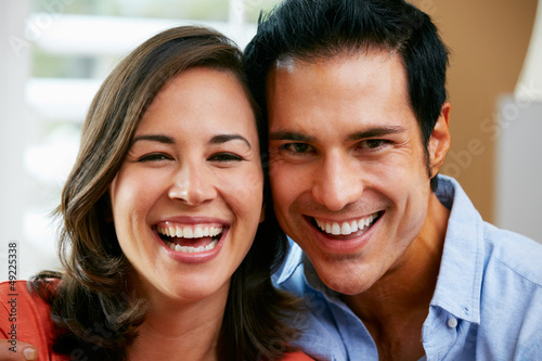 Couple Sitting On Sofa At Home Together